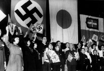 children-of-japan-germany-and-italy-meet-in-tokyo-to-celebrate-the-signing-of-the-tripartite-alliance-december-17-1940-japanese-education-minister-kunihiko-hashida-center-holding-crossed-flags-and-ma